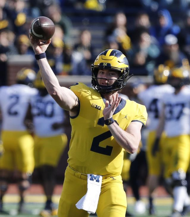 Michigan quarterback Shea Patterson throws during the team's annual spring NCAA college football game, Saturday, April 13, 2019, in Ann Arbor, Mich. (AP Photo/Carlos Osorio)