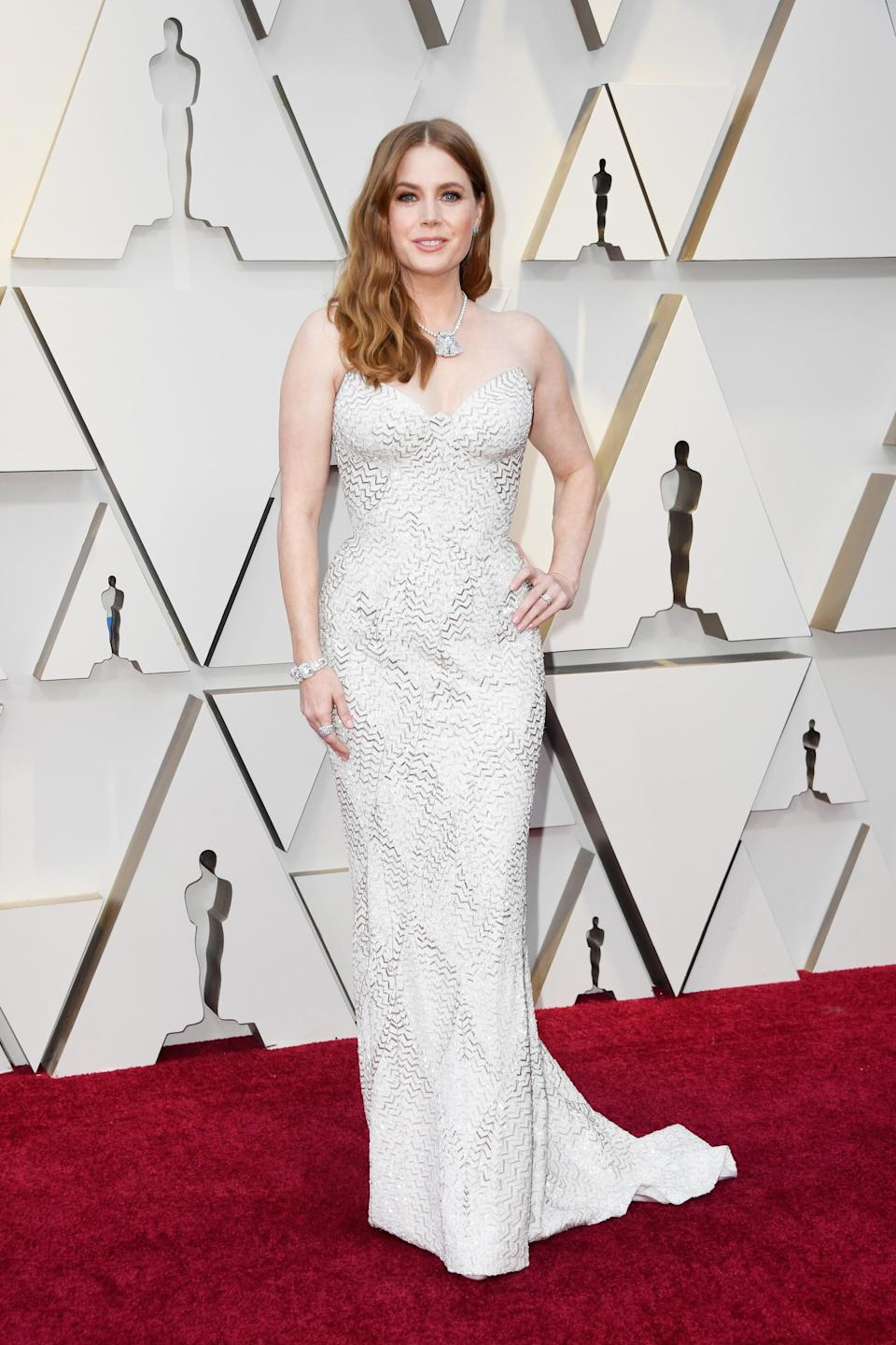 """<p>The """"Vice"""" star opted for soft waves and a curve hugging white gown with metallic detailing. <em>[Photo: Getty]</em> </p>"""