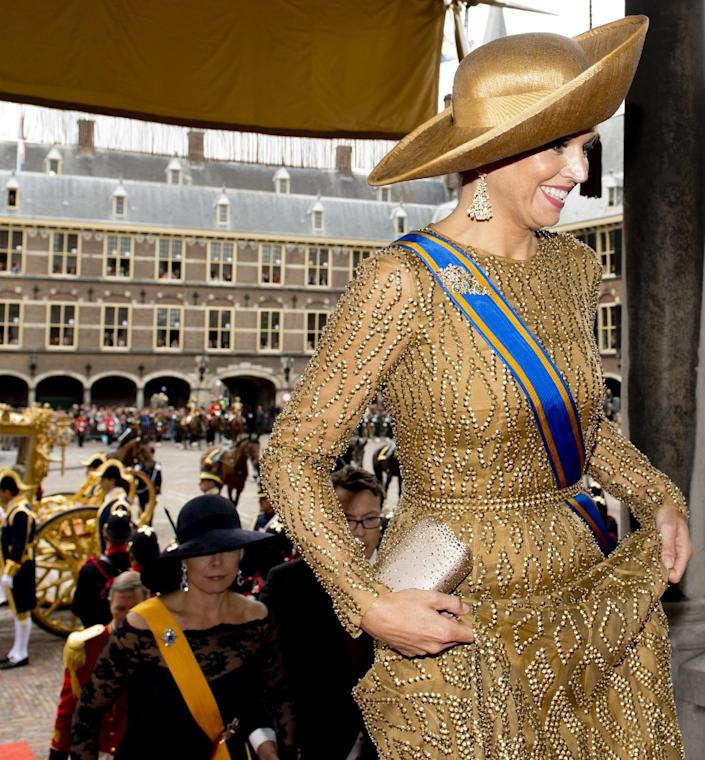 """Netherlands' Queen Maxima, right, arrives for the opening of the new parliamentary year at the 13th century """"Hall of Knights"""" in The Hague, Netherlands, Tuesday, Sept. 17, 2013. (AP Photo/Robin Utrecht, Pool)"""