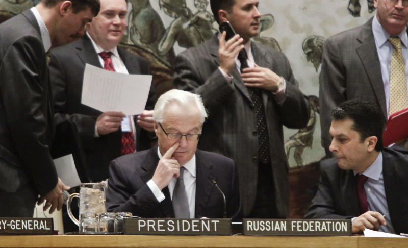 Russia's UN Ambassador Vitaly Churkin, center, current president for the U.N. Security Council, confers before leading council members on a vote for tough new sanctions against North Korea for its latest nuclear test, during a meeting at U.N. headquarters Thursday, March 7, 2013. The unanimous vote by the U.N.'s most powerful body sparked a furious Pyongyang to threaten a nuclear strike against the United States. (AP Photo/Bebeto Matthews)