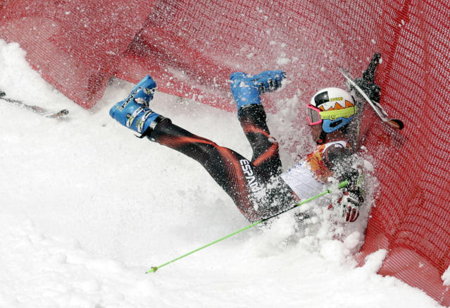 Spain's Alex Puente Tasias crashes in the first run of the men's giant slalom at the Sochi 2014 Winter Olympics, Wednesday, Feb. 19, 2014, in Krasnaya Polyana, Russia. (AP Photo/Charles Krupa)