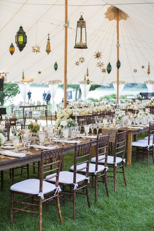 The star pendent lights hanging from the ceiling of this outdoor tent are the perfect celestial touch.