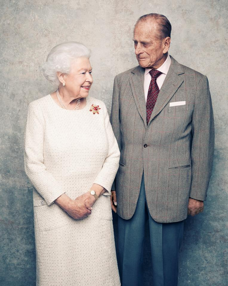 <p>A handout photo shows Britain's Queen Elizabeth and Prince Philip in the White Drawing Room at Windsor Castle in early November, pictured against a platinum-textured backdrop, in celebration of their platinum wedding anniversary on November 20, 2017. </p>