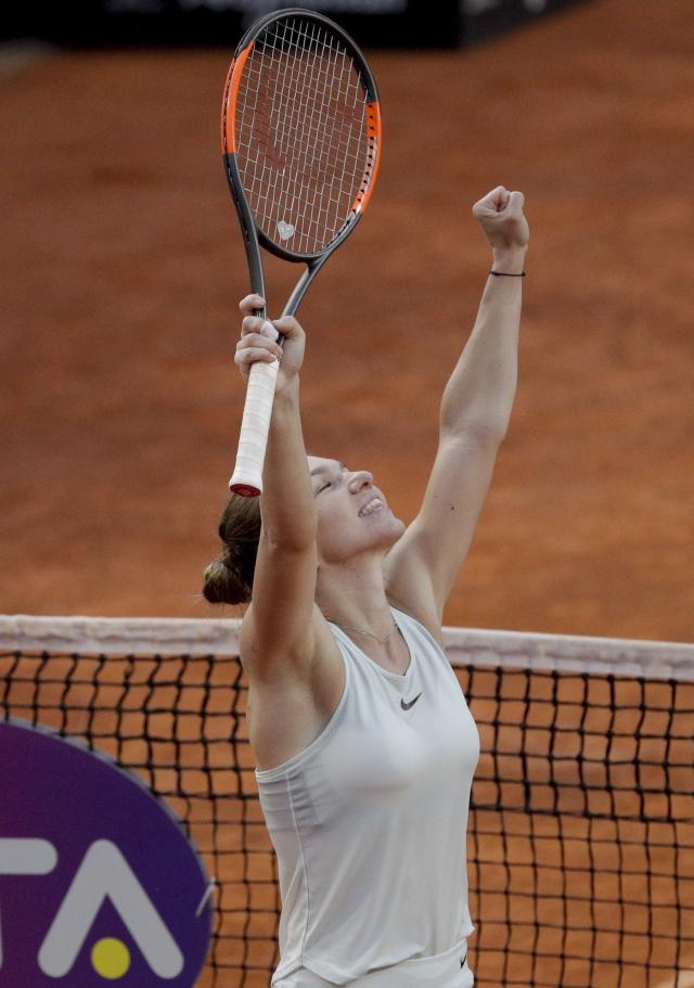 Romania's Simona Halep celebrates after beating Russia's Maria Sharapova in their semifinal match, at the Italian Open tennis tournament, in Rome, Saturday, May 19, 2018. Halep won 4-6, 6-1, 6-4. (AP Photo/Gregorio Borgia)