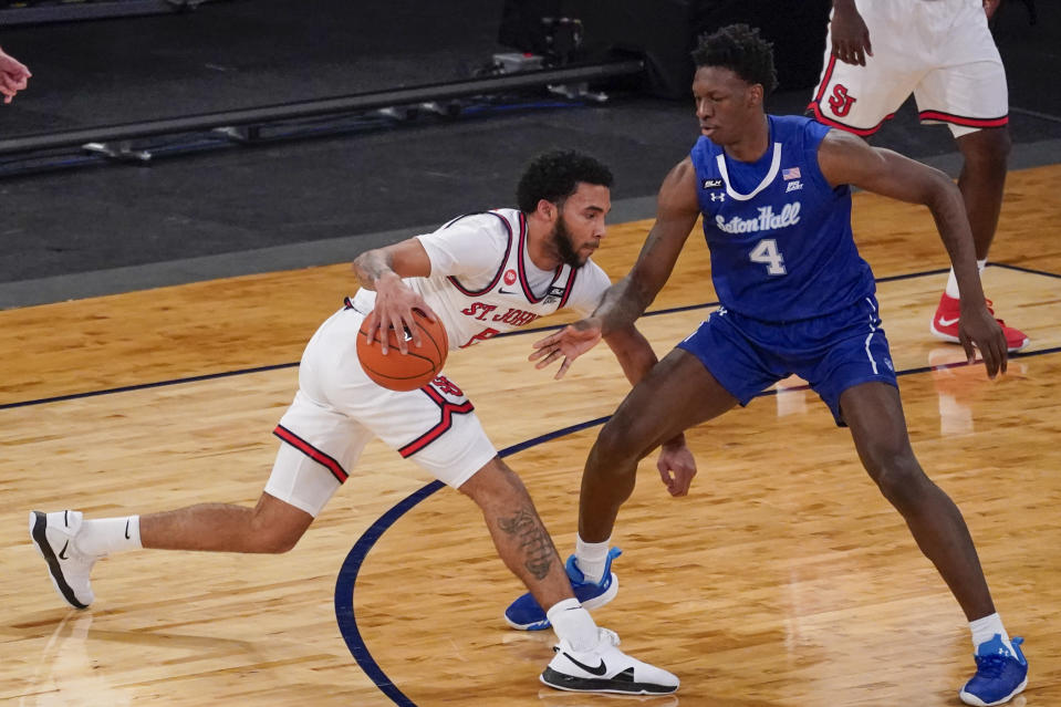 St. John's guard Julian Champagnie, left, drives against Seton Hall forward Tyrese Samuel (4) during the first half of an NCAA college basketball game in the quarterfinals of the Big East conference tournament, Thursday, March 11, 2021, in New York. (AP Photo/Mary Altaffer)