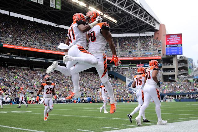 John Ross #11 (L) celebrates with Joe Mixon #28 of the Cincinnati Bengals after scoring a 33 yard touchdown pass against the Seattle Seahawks in the second quarter during their game at CenturyLink Field on September 08, 2019 in Seattle, Washington. (Photo by Abbie Parr/Getty Images)