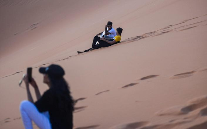 International tourists will need to wait a bit longer before then can go dune surfing in Saudi Arabia - Getty