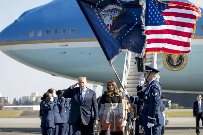 <p>President Donald Trump, left, and first lady Melania Trump arrive at Yokota Air Base, Sunday, Nov. 5, 2017, in Fussa, on the outskirts of Tokyo, Japan. Trump is on a five country trip through Asia traveling to Japan, South Korea, China, Vietnam and the Philippines. (Photo: Andrew Harnik/AP) </p>