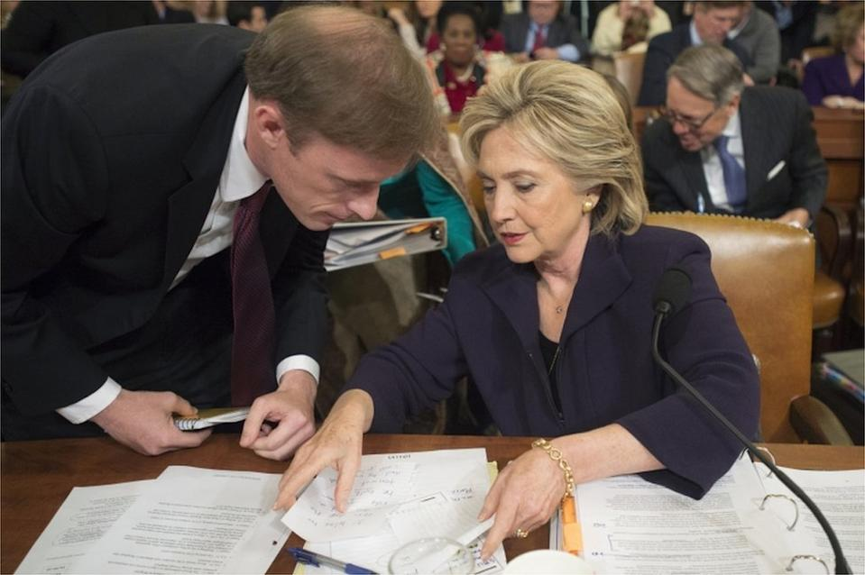 Jake Sullivan consults with former US Secretary of State Hillary Clinton during a congressional hearing
