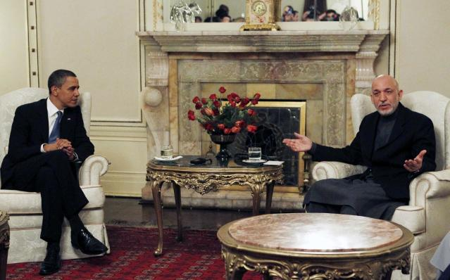 U.S. President Barack Obama meets with Afghan President Hamid Karzai at the Presidential Palace in Kabul, March 28, 2010. Obama arrived unannounced in Afghanistan on Sunday, his first visit to the war zone that could define his presidency since his election as U.S. commander-in-chief. Air Force One landed in darkness at Bagram airfield north of the Afghan capital, and Obama was whisked by helicopter to Hamid Karzai's palace in Kabul, where he was greeted by the Afghan president and a band playing the U.S. national anthem. REUTERS/Jim Young (AFGHANISTAN - Tags: POLITICS)