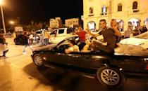 Libya unity govt cements control after rival cedes power