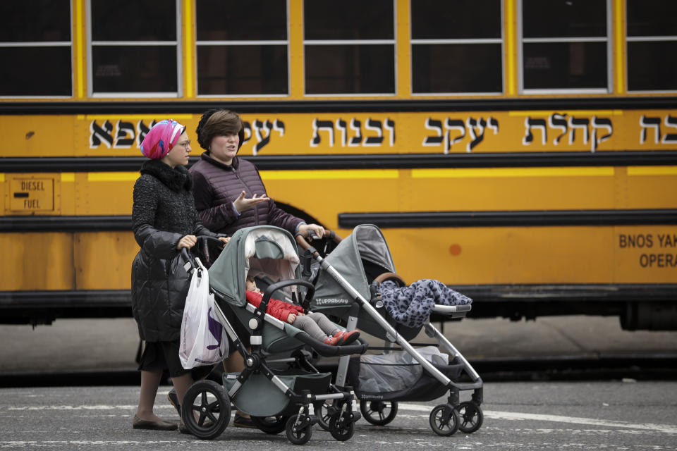 Women pushing strollers walk past the Yeshiva Kehilath Yakov School in the South Williamsburg neighborhood, April 9, 2019 in the Brooklyn borough of New York City. (Photo: Drew Angerer/Getty Images)