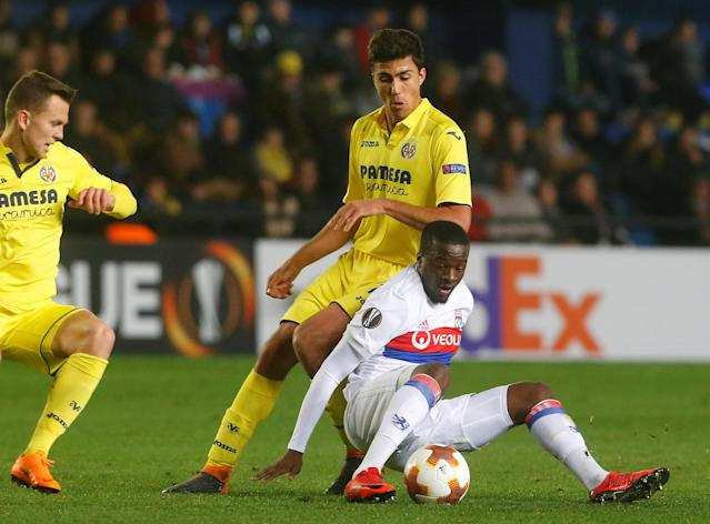 Soccer Football - Europa League Round of 32 Second Leg - Villarreal vs Olympique Lyonnais - Estadio de la Ceramica, Villarreal, Spain - February 22, 2018 Lyon's Tanguy Ndombele in action with Villarreal's Rodri REUTERS/Heino Kalis