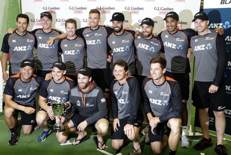 New Zealand players pose for a team photo with the trophy following play on the final day of the second cricket test between England and New Zealand at Seddon Park in Hamilton, New Zealand, Tuesday, Dec. 3, 2019. New Zealand won the series one nil after rain ended the game early. (AP Photo/Mark Baker)