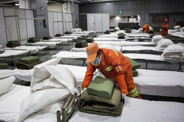 PHOTO: A cleaner checks beds at Wuhan International Conference and Exhibition Center, Feb. 4, 2020, in Wuhan, China. (Getty Images, FILE)