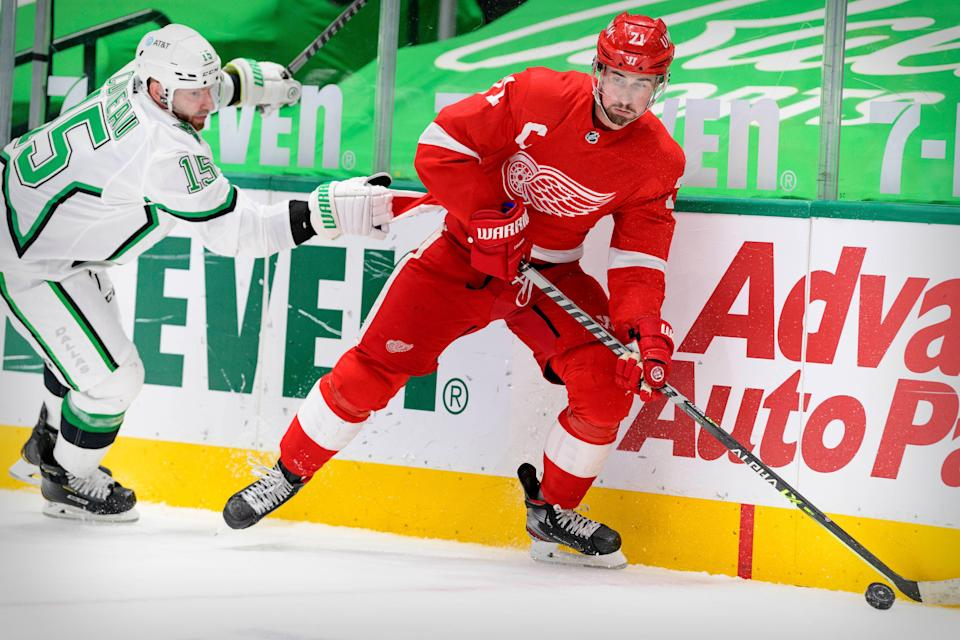 Dallas Stars left wing Blake Comeau defends Detroit Red Wings center Dylan Larkin during the third period at the American Airlines Center, April 20, 2021 in Dallas.