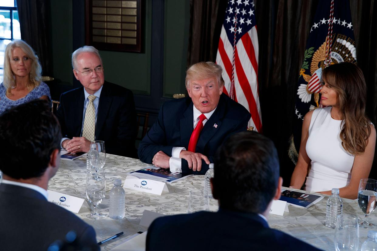 """President Donald Trump threatens North Korea with """"fire and fury"""" Aug. 8, 2017, at Trump National Golf Club in Bedminster, New Jersey. From left are, White House senior adviser Kellyanne Conway, Health and Human Services Secretary Tom Price, Trump, and first lady Melania Trump."""