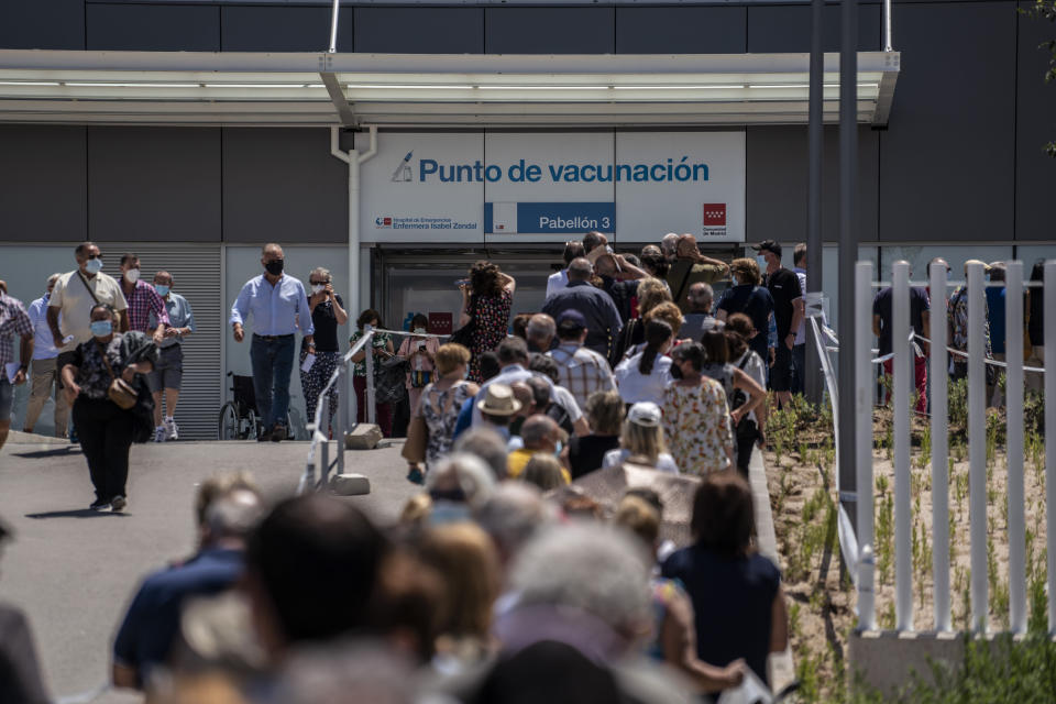 FILE - In this Tuesday, July 7, 2021 filer, hundreds of people queue to be vaccinated against COVID-19 at the Enfermera Isabel Zendal Hospital in Madrid, Spain. European nations, across the board, have made strides in their vaccination rates in recent months, with or without incentives. No country has made them mandatory, and campaigns to persuade the undecided are a patchwork. (AP Photo/Olmo Calvo, File)
