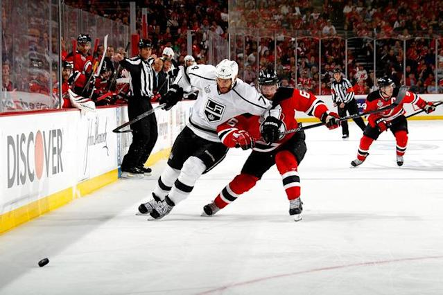 NEWARK, NJ - JUNE 09: Dwight King #74 of the Los Angeles Kings fights for position against Andy Greene #6 of the New Jersey Devils during Game Five of the 2012 NHL Stanley Cup Final at the Prudential Center on June 9, 2012 in Newark, New Jersey. (Photo by Bruce Bennett/Getty Images)