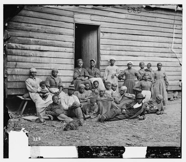 """These slaves were considered """"contraband"""" as they were being held by the Union Army."""