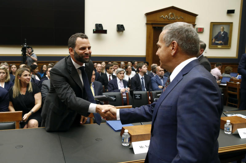 Facebook Head of Global Policy Development Matt Perault, left, shakes hands with Rep. David Cicilline, D-R.I., chair of the House Judiciary antitrust subcommittee, before testifying at a hearing, Tuesday, July 16, 2019, on Capitol Hill in Washington. (AP Photo/Patrick Semansky)