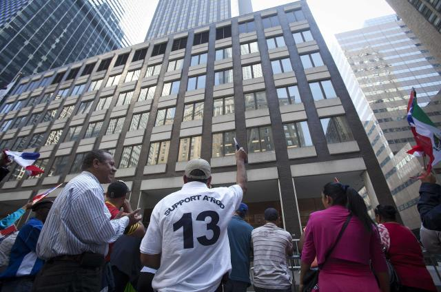 Supporters of baseball player Alex Rodriguez chant in a demonstration outside Major League Baseball's headquarters in New York October 4, 2013. New York Yankees player Rodriguez has sued Major League Baseball and its Commissioner, accusing them of improperly gathering evidence to destroy his reputation and career. Rodriguez, suspended from 211 games by Major League Baseball for doping, claims MLB interfered with his contracts and business relationships. REUTERS/Carlo Allegri (UNITED STATES - Tags: SPORT BASEBALL LAW)