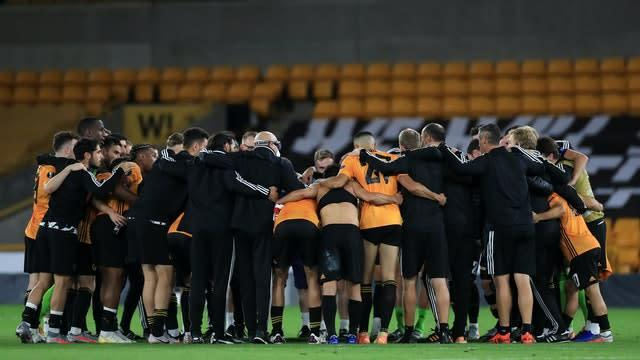 Wolves' team huddle after the game (Mike Egerton/PA Wire)