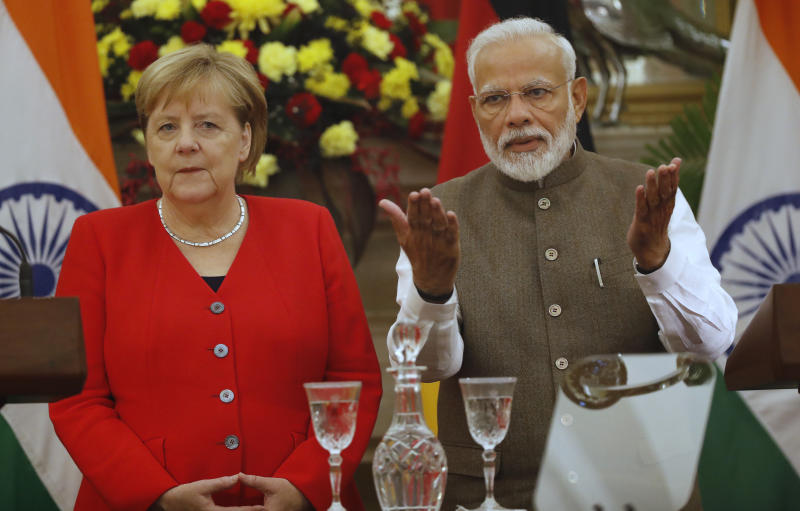 Indian Prime Minister Narendra Modi, right, gestures as German Chancellor Angela Merkel watches during a signing of agreements ceremony between the two countries, in New Delhi, India, Friday, Nov. 1, 2019. India and Germany have agreed to enhance cooperation in tackling climate change, cybersecurity, skill development, artificial intelligence, energy security, civil aviation and defense production. The two countries signed several agreements on Friday, with Prime Minister Narendra Modi saying India is eager to benefit from Germany's expertise. (AP Photo/Manish Swarup)