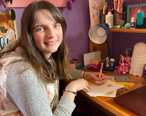 13-year-old Allison Young spent hours hand-writing letters to seniors inside a Bay Roberts retirement home, hoping to spread a little love. (Submitted by Rebecca Young - image credit)