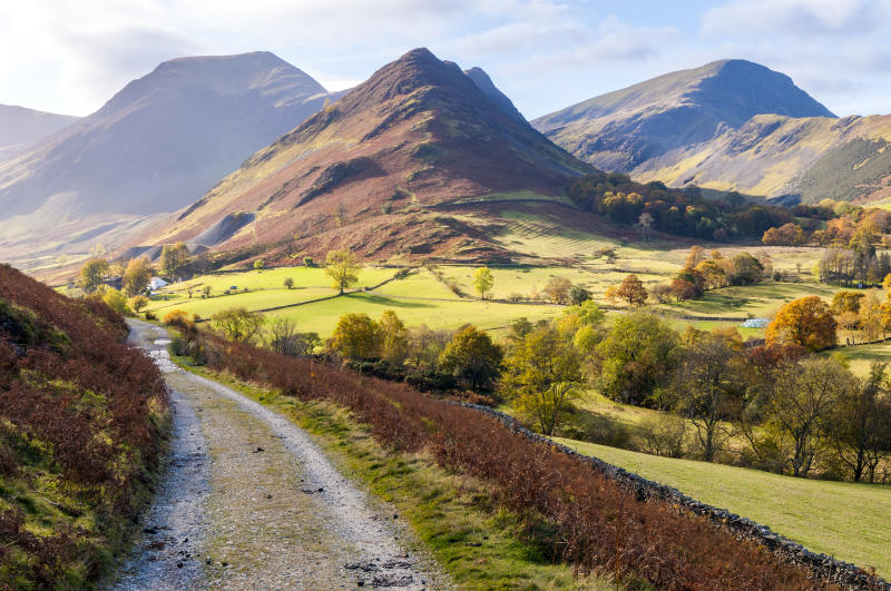 Newlands valley with surrounding mountains on a beautifully lit Autumn day. Lake District, Cumbria. UK, Europe.