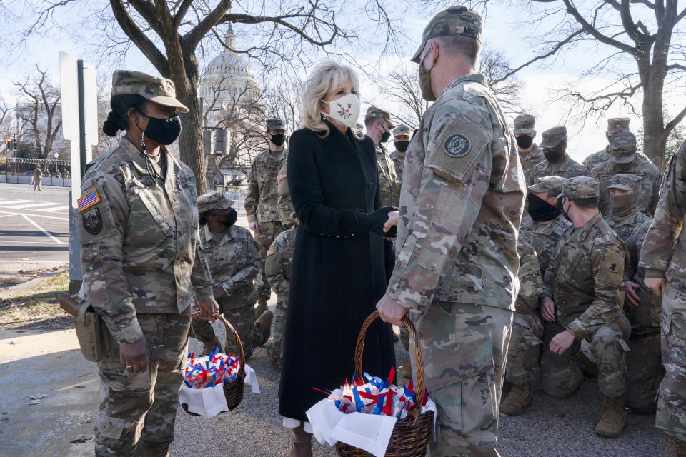 "Saying, ""The Biden's are a National Guard family,"" first lady Jill Biden greets members of the National Guard with chocolate chip cookies, Friday, Jan. 22, 2021, at the U.S. Capitol in Washington. (AP Photo/Jacquelyn Martin, Pool)"