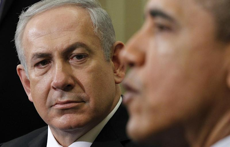 Israeli Prime Minister Benjamin Netanyahu listens as President Barack Obama speaks during their meeting, Monday, March, 5, 2012, in the Oval Office of the White House in Washington. (AP Photo/Pablo Martinez Monsivais)