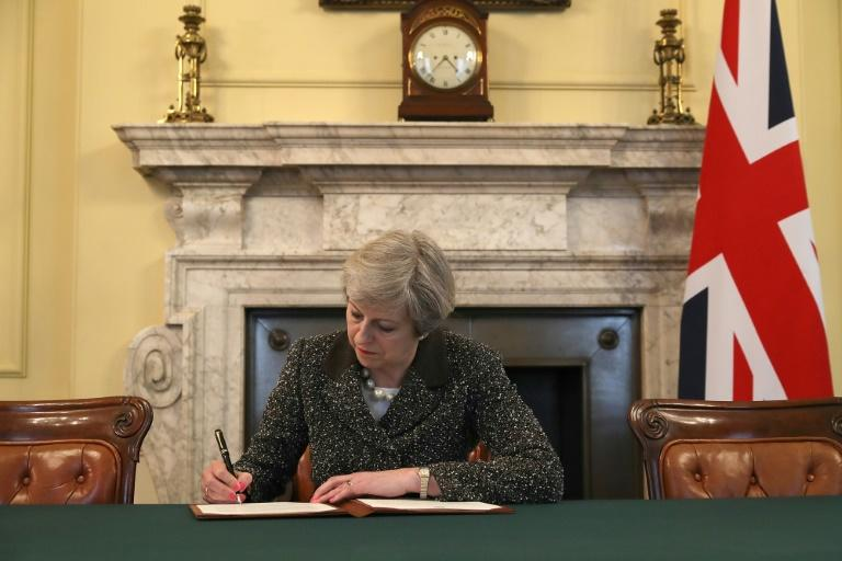 Britain's Prime Minister Theresa May signs the official letter to EU President Donald Tusk, invoking Article 50 and signalling the UK's intention to leave the European Union at 10 Downing Street, London, on March 28, 2017