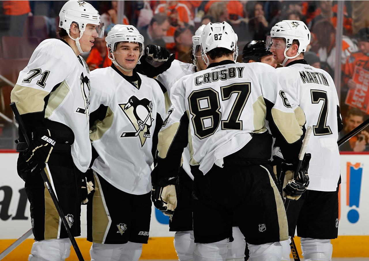 PHILADELPHIA, PA - JANUARY 19:  Evgeni Malkin #71, Sidney Crosby #87 and Paul Martin #7 celebrate the empty net goal of Chris Kunitz #14 of the Pittsburgh Penguins against the Philadelphia Flyers  at Wells Fargo Center on January 19, 2013 in Philadelphia, Pennsylvania.  (Photo by Jeff Zelevansky/Getty Images)