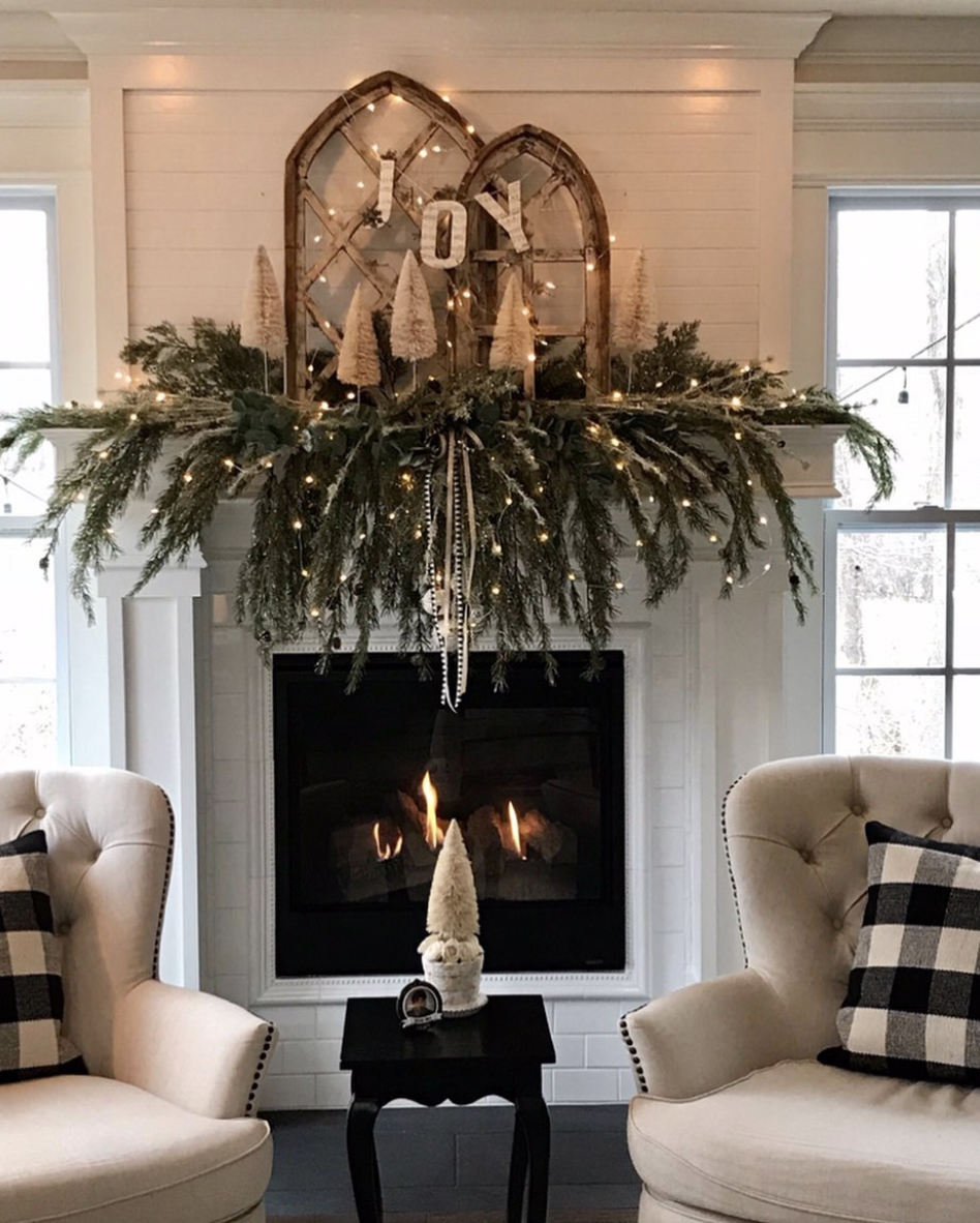 "<p>Instead of a structured garland, arrange big sprigs of evergreen on your mantel, so branches gracefully cascade from all directions. Twinkling fairy lights only serve to make the setting even more romantic. </p><p><em>See more at <a href=""https://www.instagram.com/p/B441JV1HqW_/"" rel=""nofollow noopener"" target=""_blank"" data-ylk=""slk:The Humble Haven"" class=""link rapid-noclick-resp"">The Humble Haven</a>.<br></em></p><p><a class=""link rapid-noclick-resp"" href=""https://www.amazon.com/GDEALER-Halloween-Battery-Operated-Waterproof/dp/B0744GDTB5/?tag=syn-yahoo-20&ascsubtag=%5Bartid%7C10072.g.34484299%5Bsrc%7Cyahoo-us"" rel=""nofollow noopener"" target=""_blank"" data-ylk=""slk:SHOP FAIRY LIGHTS"">SHOP FAIRY LIGHTS</a></p>"