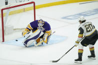 Vegas Golden Knights center Chandler Stephenson (20) scores a goal against Los Angeles Kings goaltender Calvin Petersen (40) during the second period of an NHL hockey game Wednesday, April 14, 2021, in Los Angeles. (AP Photo/Ashley Landis)
