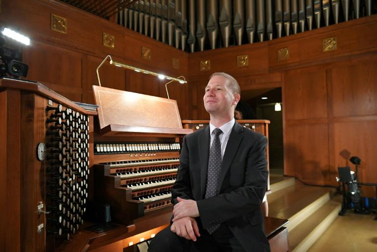 Notre Dame organist Johann Vexo sits at the organ of the Basilica of the National Shrine of the Immaculate Conception in Washington, DC, where he said the organ he played at the burned-out Paris cathedral can probably be cleaned with being taken apart