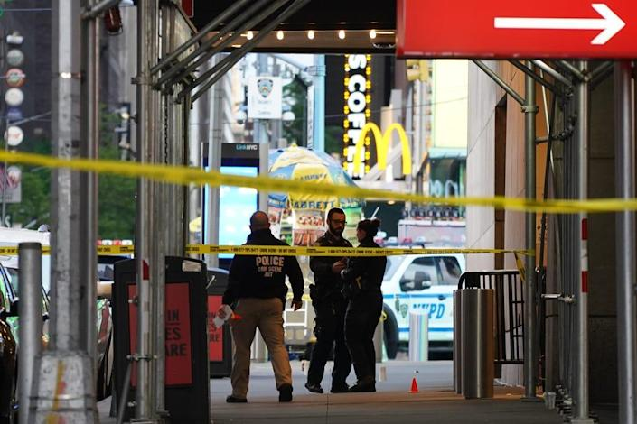 Police officers are seen next to marked shell casings from a gun in Times Square on May 8, 2021 in New York City. According to reports, three people, including a toddler, were injured in a shooting near West 44th St. and 7th Ave.