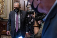 Senate Majority Leader Sen. Chuck Schumer of N.Y., leaves a Senate Democratic meeting at the Capitol in Washington, Wednesday, Oct. 6, 2021, as a showdown looms with Republicans over raising the debt limit. (AP Photo/Andrew Harnik)