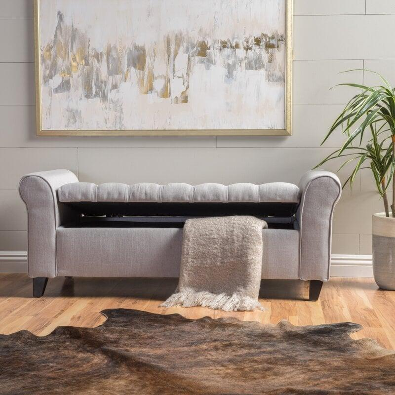 "<p>We love the design of this <a href=""https://www.popsugar.com/buy/Claxton-Upholstered-Flip-top-Storage-Bench-568399?p_name=Claxton%20Upholstered%20Flip%20top%20Storage%20Bench&retailer=wayfair.com&pid=568399&price=204&evar1=casa%3Aus&evar9=46502982&evar98=https%3A%2F%2Fwww.popsugar.com%2Fphoto-gallery%2F46502982%2Fimage%2F47545909%2FClaxton-Upholstered-Flip-top-Storage-Bench&list1=shopping%2Cfurniture%2Corganization%2Cbedrooms%2Csmall%20space%20living%2Chome%20organization&prop13=api&pdata=1"" class=""link rapid-noclick-resp"" rel=""nofollow noopener"" target=""_blank"" data-ylk=""slk:Claxton Upholstered Flip top Storage Bench"">Claxton Upholstered Flip top Storage Bench</a> ($204, originally $228).</p>"