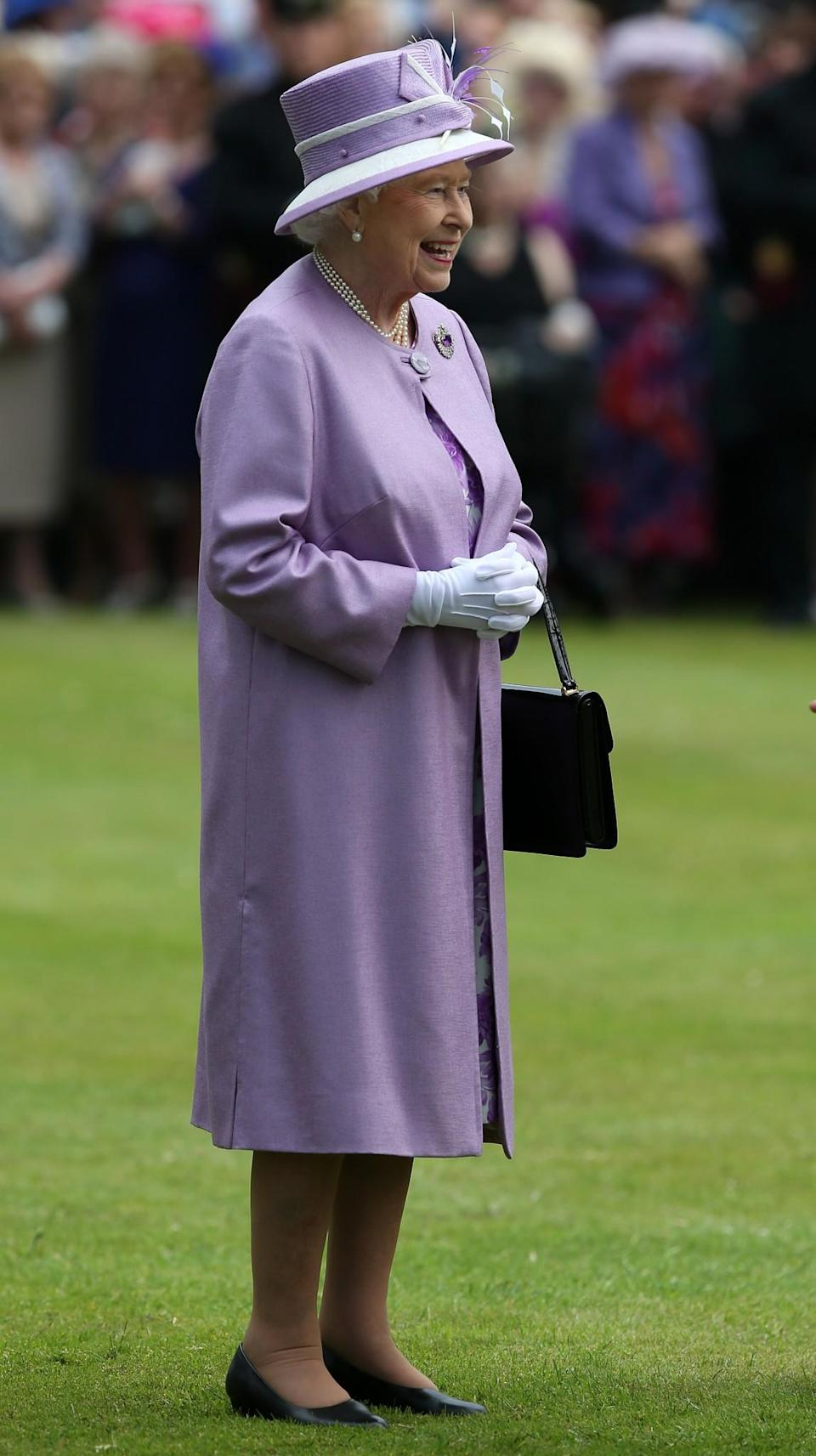 <p>The Queen opted for a pretty lilac look while in Scotland.<br><i>[Photo: PA]</i> </p>
