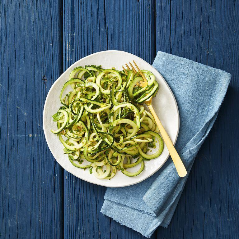 """<p>This pesto sauce is a sneaky way to pack in even more veggies into your dinner; it's <a href=""""https://www.goodhousekeeping.com/food-recipes/healthy/g1436/easy-kale-recipes/"""" rel=""""nofollow noopener"""" target=""""_blank"""" data-ylk=""""slk:made with fresh kale"""" class=""""link rapid-noclick-resp"""">made with fresh kale</a>. Nutritional yeast gives it a cheesy vibe without actually turning to (even more) cheese. </p><p><a href=""""https://www.goodhousekeeping.com/food-recipes/a29773960/keto-pesto-zucchini-noodles-recipe/"""" rel=""""nofollow noopener"""" target=""""_blank"""" data-ylk=""""slk:Get the recipe for Keto Pesto Zucchini Noodles »"""" class=""""link rapid-noclick-resp""""><em>Get the recipe for Keto Pesto Zucchini Noodles »</em></a></p>"""