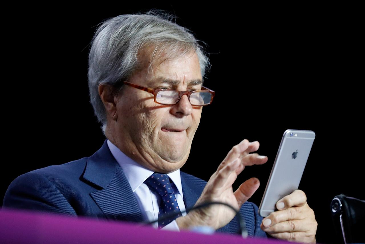 Vincent Bollore, Chairman of the Supervisory Board of media group Vivendi checks his mobile phone while attending the company's shareholders meeting in Paris, France, April 19, 2018. REUTERS/Charles Platiau