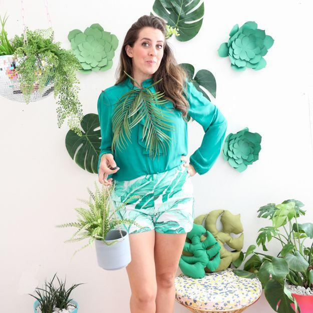 """<p>Since your green thumb is greener than most, show it off this Halloween by dressing as the ultimate #PlantLady, faux leaves and all. </p><p><a class=""""link rapid-noclick-resp"""" href=""""https://www.amazon.com/Artificial-Greenery-Tropical-Monstera-Arrangement/dp/B07NRLTZ9Z/?tag=syn-yahoo-20&ascsubtag=%5Bartid%7C10055.g.2750%5Bsrc%7Cyahoo-us"""" rel=""""nofollow noopener"""" target=""""_blank"""" data-ylk=""""slk:SHOW FAUX PALM LEAVES"""">SHOW FAUX PALM LEAVES</a></p><p><em><a href=""""https://akailochiclife.com/2017/10/diy-it-plantlady-costume.html"""" rel=""""nofollow noopener"""" target=""""_blank"""" data-ylk=""""slk:Get the tutorial at A Kailo Chic Life »"""" class=""""link rapid-noclick-resp"""">Get the tutorial at A Kailo Chic Life »</a></em></p>"""