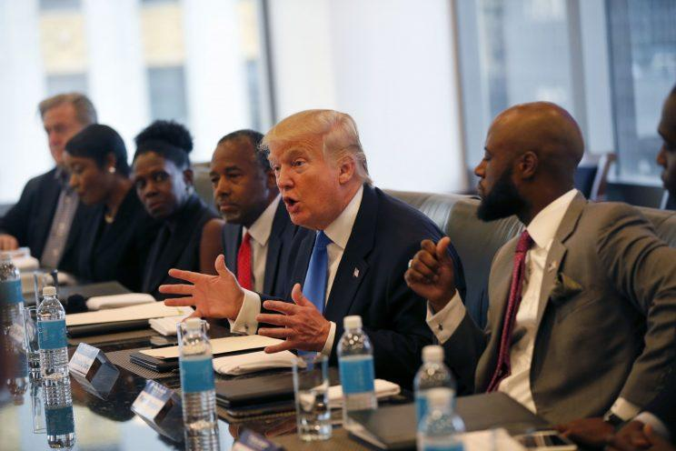 Donald Trump, with Ben Carson to his right, meets with the Republican Leadership Initiative at Trump Tower in New York on Thursday. (Photo: Gerald Herbert/AP)