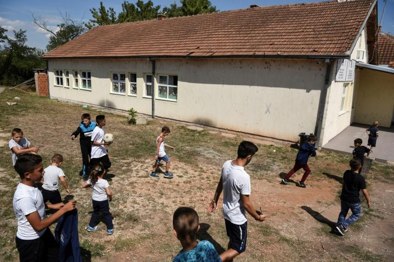 In their ethnically divided school, Kosovo Albanian children only meet up with their Serb counterparts on the playing field