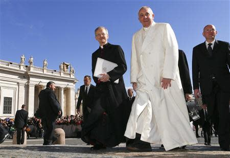Pope Francis walks as he arrives to lead the general audience in Saint Peter's Square at the Vatican