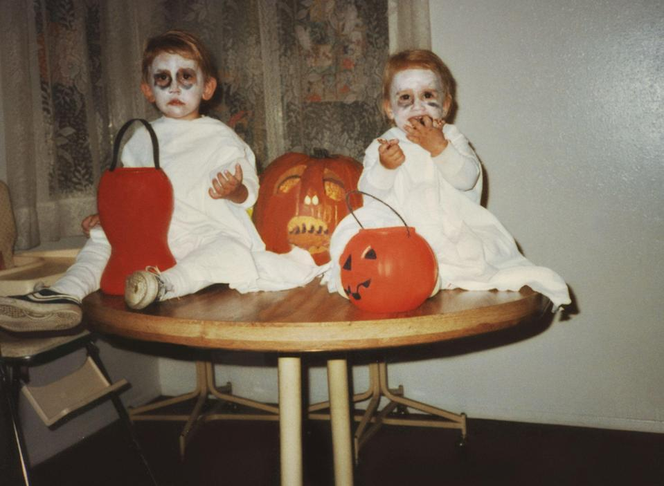 """<p>Today, we associate October 31 with candy, <a href=""""https://www.countryliving.com/diy-crafts/g4571/diy-halloween-costumes-for-women/"""" rel=""""nofollow noopener"""" target=""""_blank"""" data-ylk=""""slk:costumes"""" class=""""link rapid-noclick-resp"""">costumes</a>, and spooky <a href=""""http://www.countryliving.com/diy-crafts/how-to/g1024/do-it-yourself-halloween-decorations-1010/"""" rel=""""nofollow noopener"""" target=""""_blank"""" data-ylk=""""slk:Halloween decorations"""" class=""""link rapid-noclick-resp"""">Halloween decorations</a>. But have you ever thought about <a href=""""https://www.countryliving.com/entertaining/a40250/heres-why-we-really-celebrate-halloween/"""" rel=""""nofollow noopener"""" target=""""_blank"""" data-ylk=""""slk:why we really celebrate Halloween"""" class=""""link rapid-noclick-resp"""">why we really celebrate Halloween</a> in the first place and how the ghoulish holiday has evolved over the years? You may also be wondering how the custom of <a href=""""https://www.countryliving.com/life/kids-pets/a23932768/what-time-does-trick-or-treating-start/"""" rel=""""nofollow noopener"""" target=""""_blank"""" data-ylk=""""slk:trick-or-treating"""" class=""""link rapid-noclick-resp"""">trick-or-treating</a> originally came to be, as well as what characters people used to dress up as back in the day. Believe it or not, there's a lot of info about vintage Halloween you might not know, like the fact that party planning in the early 1920s would start as early as August, or that apple-bobbing emerged as a popular All Hallow's Eve pastime (and superstitious matchmaking opportunity!). We took a look back at Halloween fads from every year within the past century, starting with 1916 and working up to present day. Whether you're interested in learning about the haunted occasion the year you were born or just want to curb your Halloween curiosity, take a zombie crawl down memory lane with every tradition, fun fact, and pop culture inspiration that's emerged from October 31. Ready for a spooky look back at the history of Halloween in America? Read on, if you """
