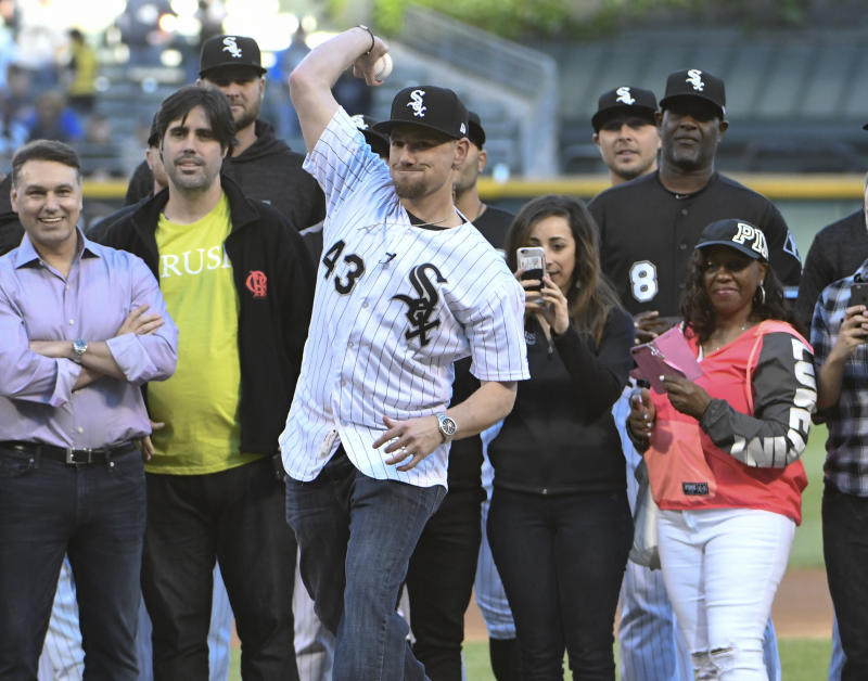 Chicago White Sox pitcher Danny Farquhar (43) throws out a ceremonial first pitch before a baseball game between the White Sox and the Milwaukee Brewers on Friday, June 1, 2018, in Chicago. Farquhar was hospitalized after suffering a ruptured brain aneurysm during a baseball game in April. (AP Photo/David Banks)