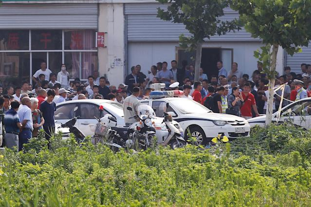 <p>Onlookers and security personnel gather near the scene of an explosion at a kindergarten in Fengxian County in Jiangsu Province, China, June 16, 2017. (Photo: Aly Song/Reuters) </p>